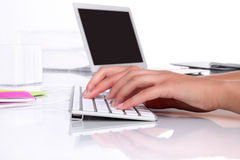 Hands in office desk typing on keyboard Stock Photo