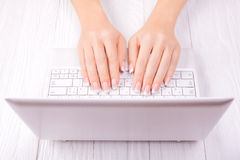 Hands of an office woman typing Royalty Free Stock Photography