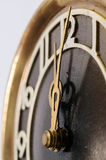 Hands old clock on the background of the figure twelve. Close up Stock Photo