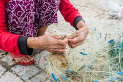 Hands of the old fisherman untangles fishing nets, Nha Trang Royalty Free Stock Images