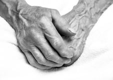 Hands of the old man. Black and white. top view Stock Image