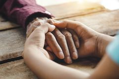 Hands of the old man and a child`s hand royalty free stock photo