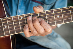 Hands of the old man hold guitar Stock Photo