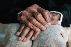 Hands of an old man with wrinkled stock image