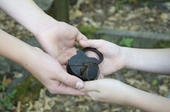 Hands with a old padlock and key royalty free stock images