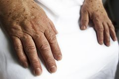 Hands of old person. 2 hands of an old person on the white background royalty free stock photos