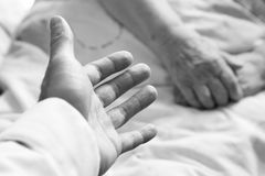 Hands of an old person. In bed stock images