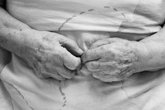 Hands of an old person. In bed Royalty Free Stock Images