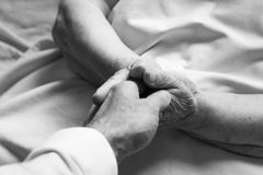 Hands of an old person. In bed royalty free stock photos