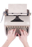 Hands on a old typing machine Royalty Free Stock Image