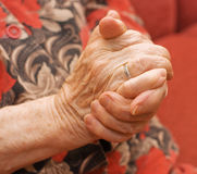 Hands of the old woman royalty free stock photography