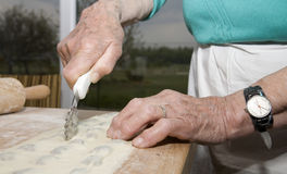 Hands of old woman by baking Stock Photo