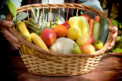 In hands of an old woman, basket is full of healthy food Stock Photography