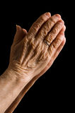 Hands of the old woman on a black Stock Image