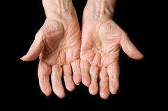 Hands of old woman on black Stock Photography