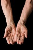 Hands of old woman on black Royalty Free Stock Photo