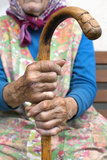 Hands of an old woman with a cane Stock Photo