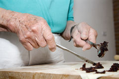 Hands of old woman at cooking Royalty Free Stock Images