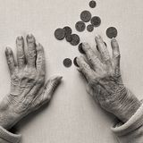 Poverty. Hands of old woman, counting money coins of Shekel Israeli. Poverty concept royalty free stock photo