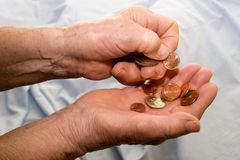 Hands of old woman with the euro Stock Photo