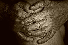Hands of an old woman. On her knees crossed Royalty Free Stock Image