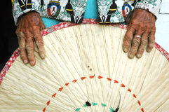 Hands of an old woman. Holding a traditional woven hats Royalty Free Stock Photo