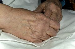 Hands of an old woman. Kneeling close-up Royalty Free Stock Images