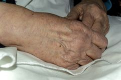 Hands of an old woman. Kneeling close-up Royalty Free Stock Photos
