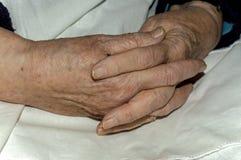 Hands of an old woman. Kneeling close-up Stock Photos
