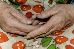 Hands of an old woman. Kneeling close-up Royalty Free Stock Image