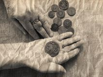 Hands of old woman. Magnifying glass  and money.selective soft focus.The concept of poverty in retirement Stock Images
