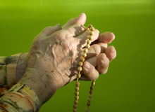 Hands of old woman by prayer Royalty Free Stock Photography