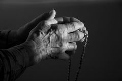 Hands of old woman by prayer Stock Images