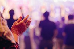 Hands old woman raised up worship to God. At music concert Royalty Free Stock Photos