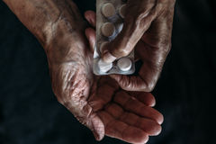 Hands of old woman with tablets or pills. Health care and Taking medication of old people stock images