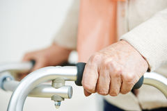 Hands of old woman on walker Royalty Free Stock Photography