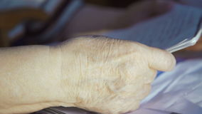 Hands of old woman who keeps covenant. 4k stock footage