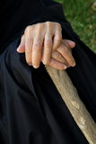 The hands of an old woman on a wooden stick Royalty Free Stock Image