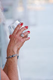 Hands of Older Woman Holding Drink Royalty Free Stock Photography