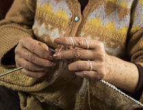 Hands of an older woman knitting Royalty Free Stock Image