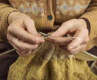 Hands of an older woman knitting Royalty Free Stock Photo
