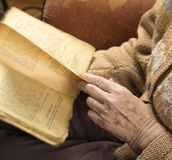 Hands of an older woman reading book Stock Photo