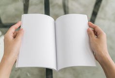 Hands open book on table . Royalty Free Stock Photo