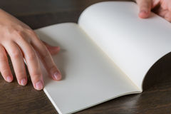 Hands open book Stock Photos