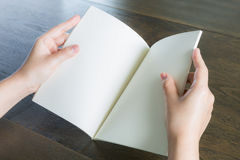 Hands open book Stock Photo