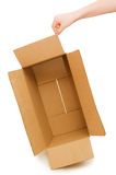 Hands open a cardboard box isolated Stock Image