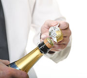 Hands open champagne Royalty Free Stock Image