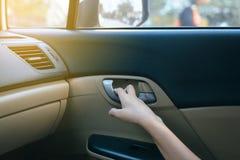 Hands open door car and lock door control panel of auto button glass controlling window in the car stock photos