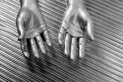 Hands open futuristic robot silver steel over gray Royalty Free Stock Photos