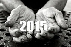 2015 in the hands. Open hands holding number 2015. Happy New Year. Selective focus on fingers Royalty Free Stock Photo